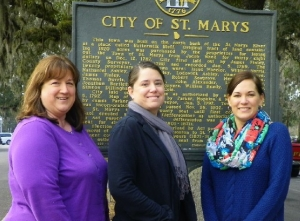 Nicole Goebel and ladies in front of the City of St. Marys sign